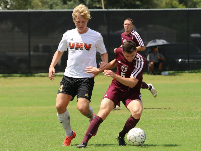 Houston-Victoria's Espen Hansen (left) netted the first three goals of his college career last week.