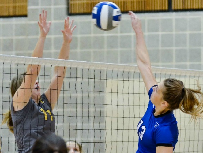 OLLU's Jessica Walaski (right) established a new school record with 10 blocks in a victory over Texas Lutheran.