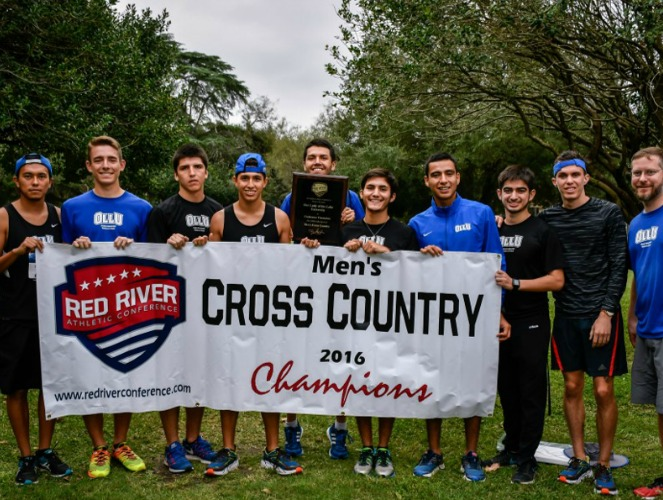 OLLU holds up its second consecutive RRAC men's cross country banner.