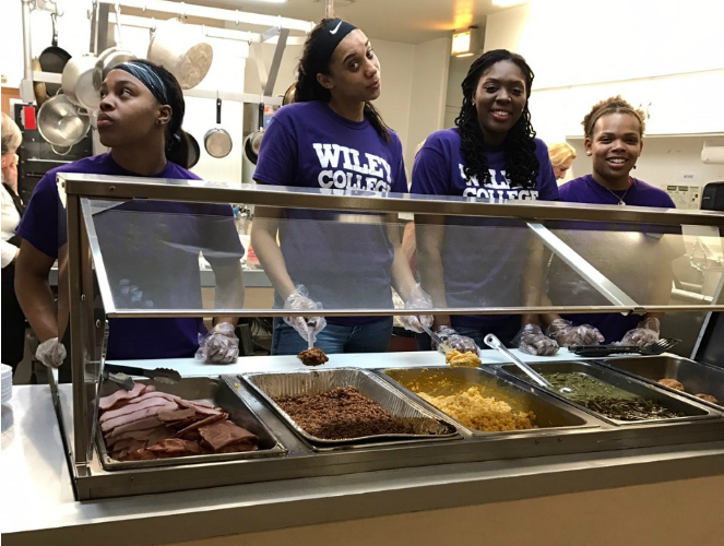 The Lady Wildcats served food to families Thursday night at Martha's Kitchen