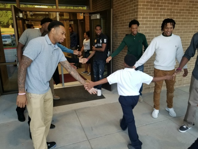 Photo for Wiley student-athletes support Million Father March at area schools
